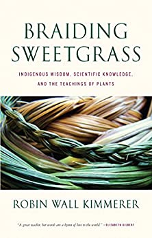 The cover of Braiding Sweetgrass shows several plaits of braided sweetgrass.