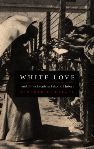 The cover of White Love is a black and white photo. A barbed wire fence divides two sides. On one side is a woman in a pale dress standing beneath an umbrella, her upper body completely hidden in shadow. On the other side rows of people reach towards her through the fence, unable to touch her.