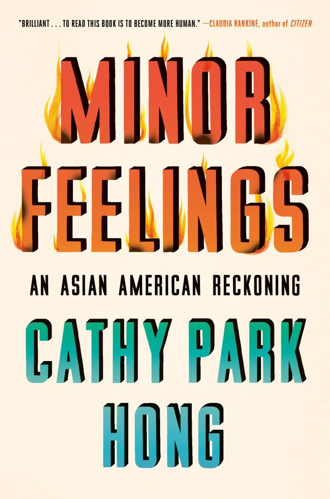 The cover of Minor Feeling shows the title wreathed in flames.